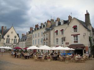 Blois - Houses and cafe terraces on Château square with a turbulent sky