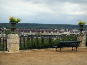Blois - Terrace of the Bishop's palace gardens with a bench and flowers, a view of the houses of the opposite bank