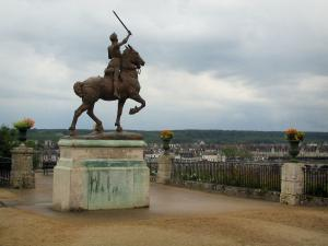 Blois - Terrace of the Bishop's palace gardens with a statue of Joan of Arc, cloudy sky