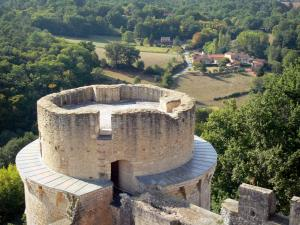 Bonaguil castle - View on the top of the main tower and the surrounding landscape from the terrace of the keep