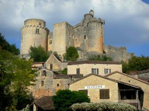 Bonaguil castle - Fortress (fortified castle) overlooking the houses of the village of Bonaguil