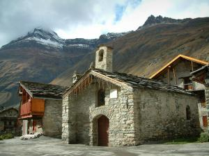 Bonneval-sur-Arc - Chapel, stone houses and mountains with snowy tops, in Haute-Maurienne (Vanoise national park)