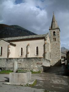 Bonneval-sur-Arc - Fountain and church in the Savoyard village with a cloudy sky, in Haute-Maurienne (Vanoise national park)