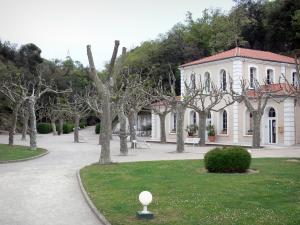 Le Boulou - Spa town: facade of the spa establishment (thermes) and square planted with plane trees