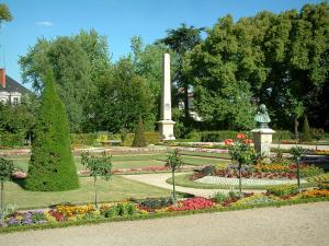 Bourges - Flowerbeds, statue and trees of the Archbishop's palace garden