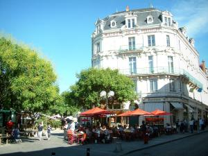Bourges - Cujas square with a café terrace, a building (Forestine house) and trees