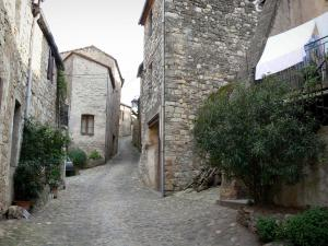 Boussagues - Sloping narrow paved street lined with stone houses