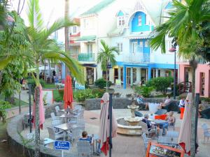 Bout headland - Café terrace and shops of the Village Creole