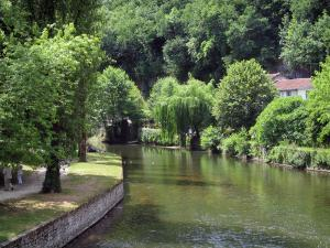 Brantôme - Bank of the Monks garden (on the left), Dronne river and trees along the water, in Green Périgord