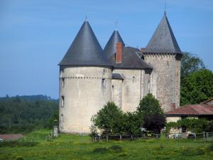 Brie castle - Fortified house, prairie and trees, in the Périgord-Limousin Regional Nature Park