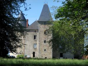Brie castle - Fortified house and trees, in the Périgord-Limousin Regional Nature Park