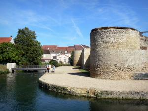 Brie-Comte-Robert castle - Towers and walls of the medieval castle, moat, bridge and houses in the city