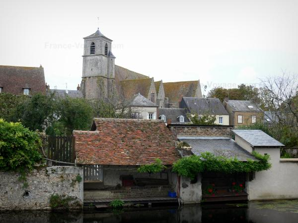 Brou - Bell tower of the Saint-Lubin church, houses of the city and ancient lavoirs (communal washing places) along the water (Ozanne river)