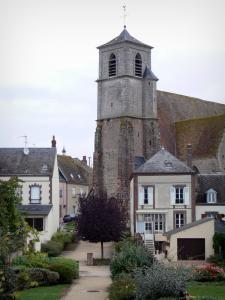 Brou - Saint-Lubin church with its bell tower and houses of the city