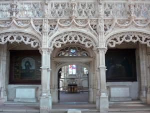 Brou Royal Monastery - Inside the Brou church of Flamboyant Gothic style: rood screen and its stone lace; in the town of Bourg-en-Bresse