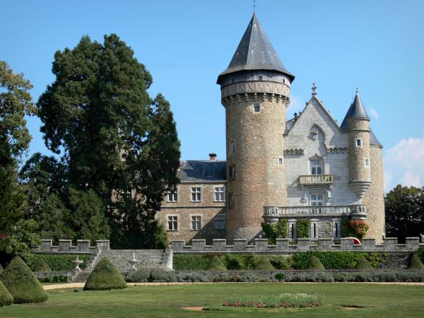 Busset castle - French-style formal garden, Orion tower and main building of the castle