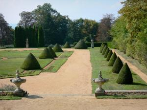 Busset castle - French-style formal garden with hand-clipped shrubs, lawns and flowers