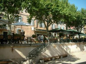 La Cadière-d'Azur - Stairs, cafe terraces, parasols, plane trees and houses of the medieval village