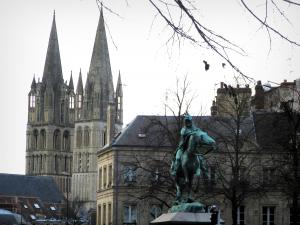 Caen - Statue of the Saint-Martin square, trees, building, and towers of the Saint-Etienne church (Abbaye-aux-Hommes abbey)