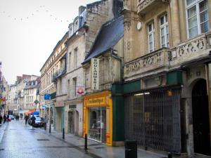 Caen - Houses and shops in a street of the city