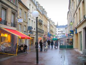 Caen - Street of the city with houses, shops, cafés and lampposts