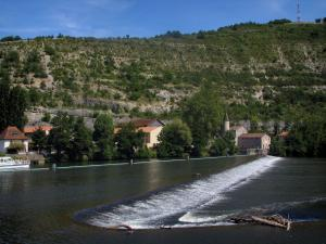 Cahors - The River Lot, boat, houses and hill, in the Quercy