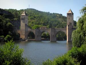 Cahors - Valentré bridge (fortified bridge), the River Lot and trees, in the Quercy