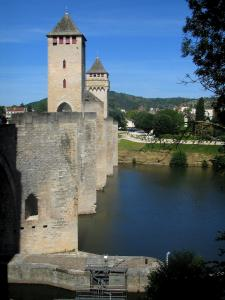 Cahors - Towers and fronts of the Valentré bridge (fortified bridge) and the River Lot, in the Quercy