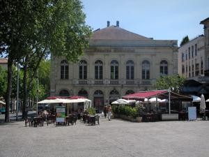 Cahors - Municipal theatre, trees and café terraces of the François-Mitterrand square, in the Quercy