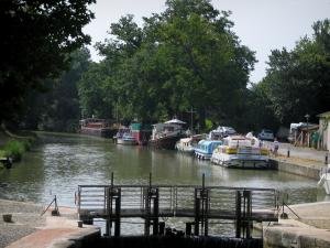 Canal du Midi - Gardouch lock, canal with barges and moored boats, and trees