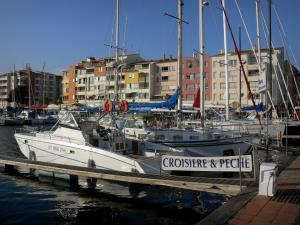 Le Cap-d'Agde - Boats and sailboats of the sailing port, and buildings of the seaside resort
