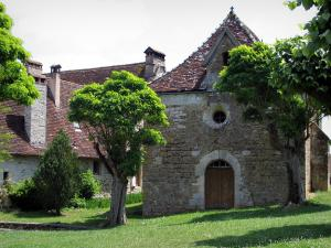 Carennac - Chapel, public garden featuring trees and houses of the village, in the Quercy