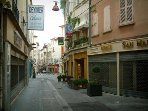 Carpentras - Street in the old town with its houses and shops