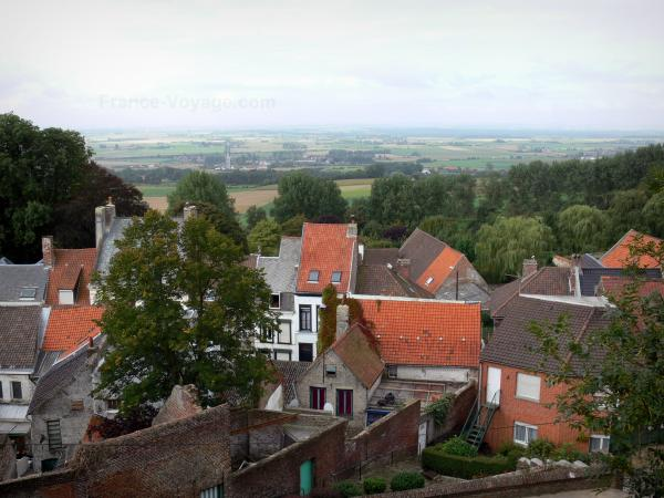Cassel - From the Cassel mountain, view of the roofs of the houses of the city, trees and landscapes of the Flanders plain