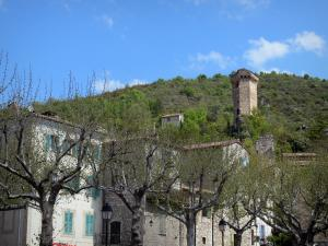 Castellane - Pentagonal tower overlooking trees and houses of the old town