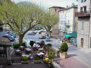 Castellane - Église square: café terrace, trees and facades of houses