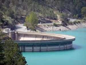 Castillon lake - Castillon dam, emerald-coloured lake (water reservoir), route and trees; in the Verdon Regional Nature Park
