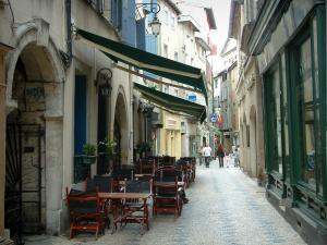 Castres - Narrow street, café terrace, shops and houses in the old town