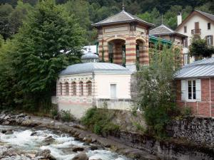 Cauterets - Spa town and health resort: River Gave de Cauterets and buildings along the water, gare des Oeufs station