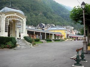 Cauterets - Spa town and health resort: Esplanade des Oeufs square with benches, gallery and buildings of the town