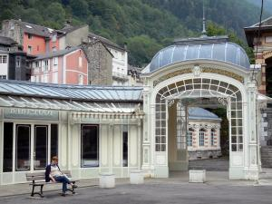 Cauterets - Spa town and health resort: pavillon of the gallery of Esplanade des Oeufs square and buildings of the town in the background