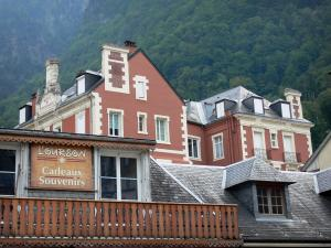 Cauterets - Spa town and health resort: roofs and facades of buildings in the town