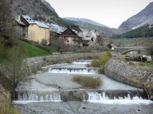 Cervières - Houses of the village on the Cerveyrette torrent and mountains