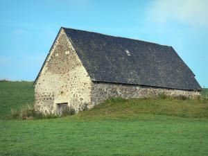 Cézallier mountains - Stone hut in the middle of a pasture; in the Auvergne Volcanic Regional Nature Park
