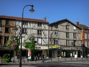Châlons-en-Champagne - République square: timber-framed houses, shops, lamppost decorated with flowers