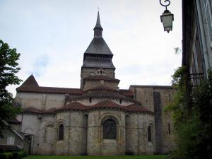 Chambon-sur-Voueize - Bell tower and chevet of the Sainte-Valérie abbey church of Romanesque Limousin style, lamppost