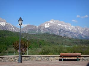 Champsaur valley - Lamppost and bench in Saint-Bonnet-en-Champsaur, view of trees, prairies and the Dévoluy mountain range in background