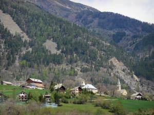 Champsaur valley - Church and chalets of a village, prairies, trees and mountain