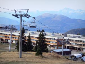 Chamrousse - Chairlift and buildings of the ski resort overhanging the surrounding mountains