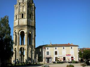 Charroux - Octagonal tower said Charlemagne tower (remains of the Saint-Sauveur abbey), houses of the city, café terrace and lampposts